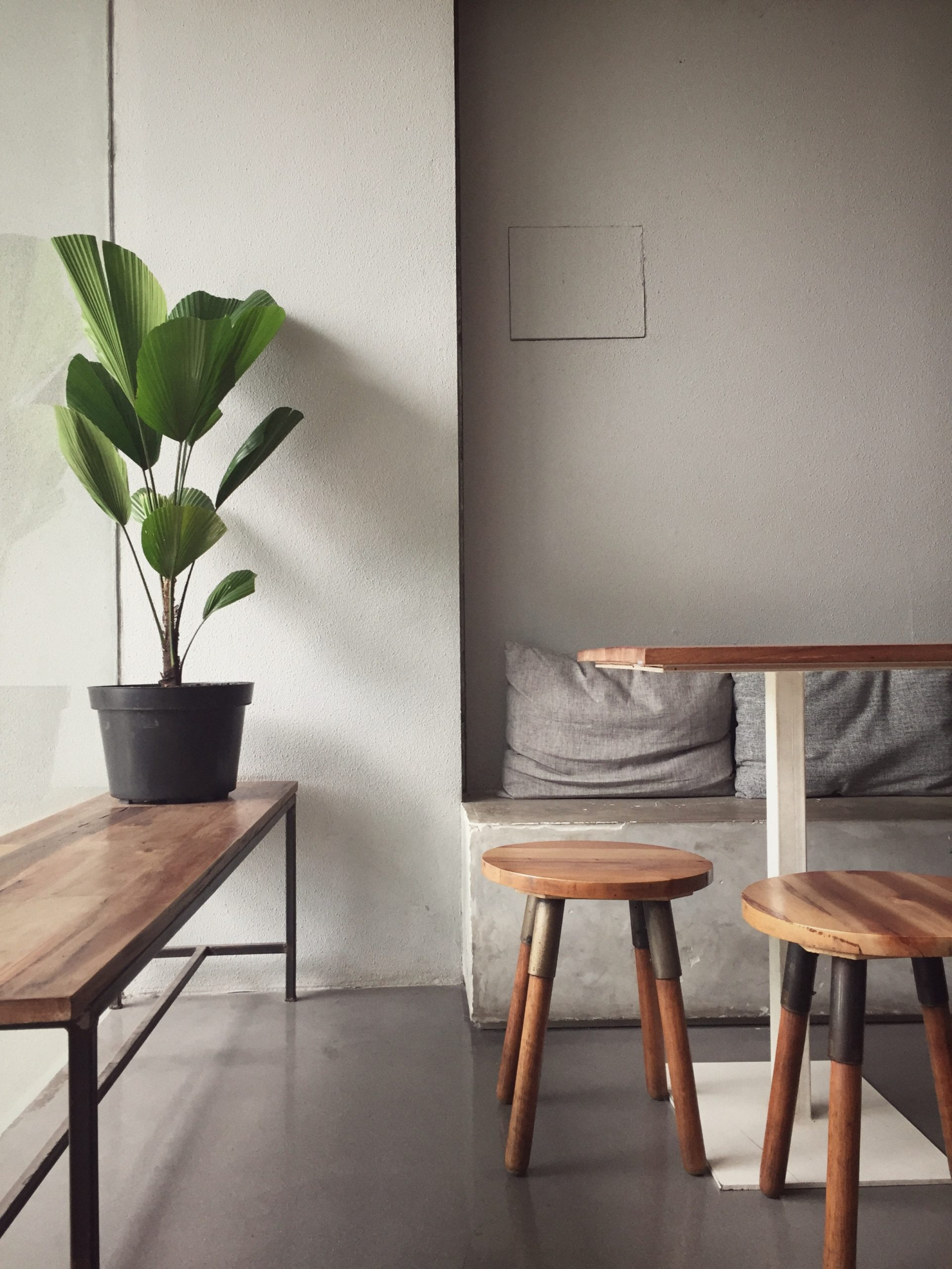 wooden-bench-and-stools-in-a-cozy-room-3049121